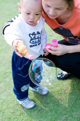 mom and baby blowing bubbles - Late Talkers Foundation
